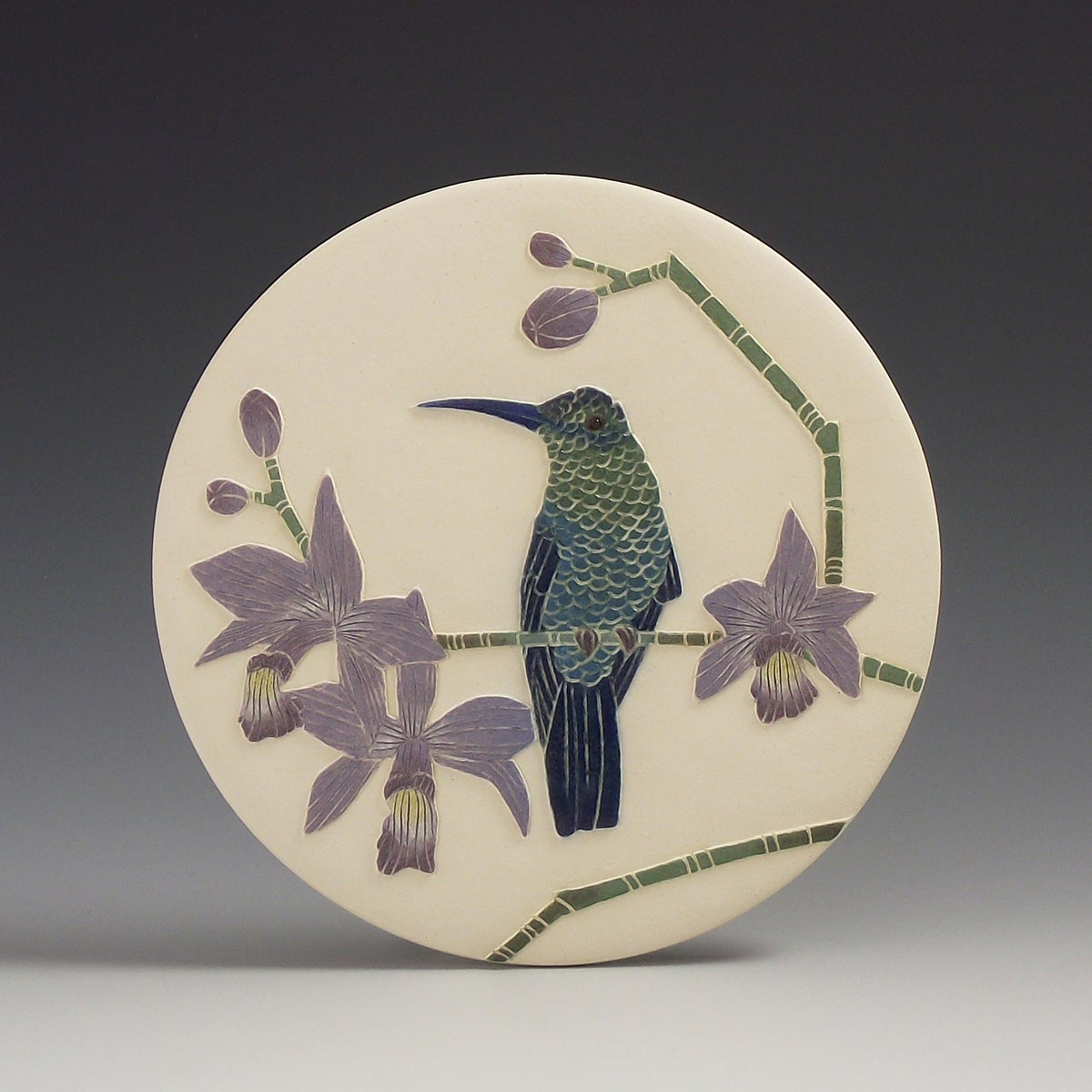 Violet capped hummingbird carved wall hanging