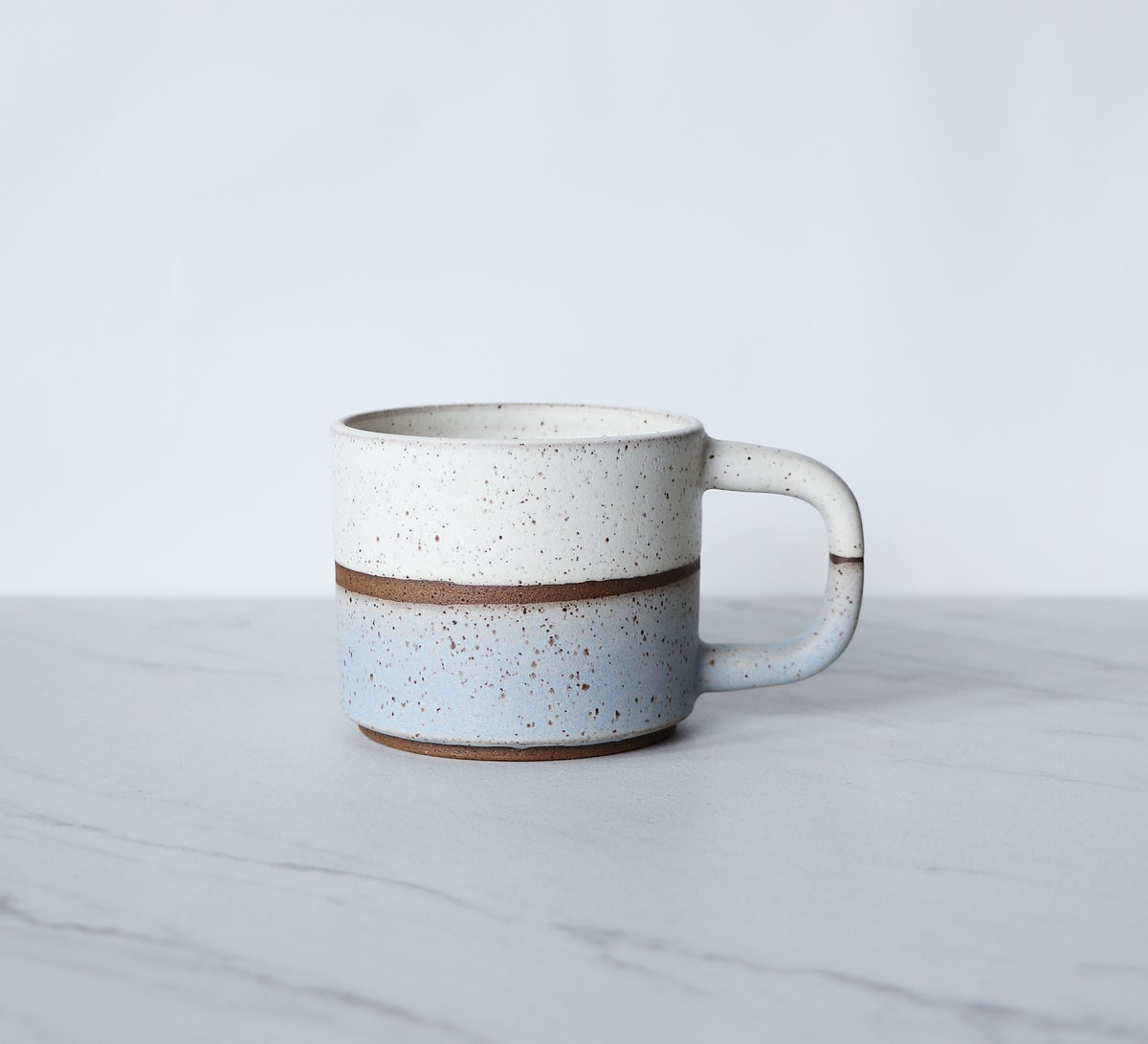 Image of Short coffee mug, speckled clay glazed in cream + ice