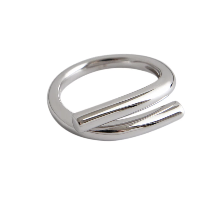 DISTINCTIVE BOLD PIECE WITH TIMELESSNESS IN IT'S LOOK  The adjustable size ring is a one size fits most since you can simply open or close the shape to fit your finger. The approximate fit is between EU sizes 15,5 - 19 and US sizes 5 - 9.  A modern take on fine jewelry is expressed through the clean lines. This sculptural yet lightweight ring is crafted from sterling 925 silver, and given a polished shine so it will catch and reflect sunlight.  This Unity wire piece is cr...