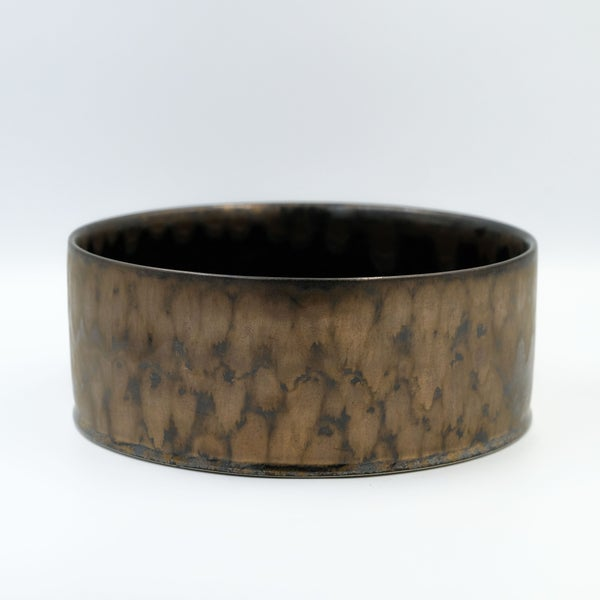 Image of  UNIKA CYLINDER BOWL IN BRONZE GLAZE WITH A BLACK GLOSSY GLAZE INTERIOR