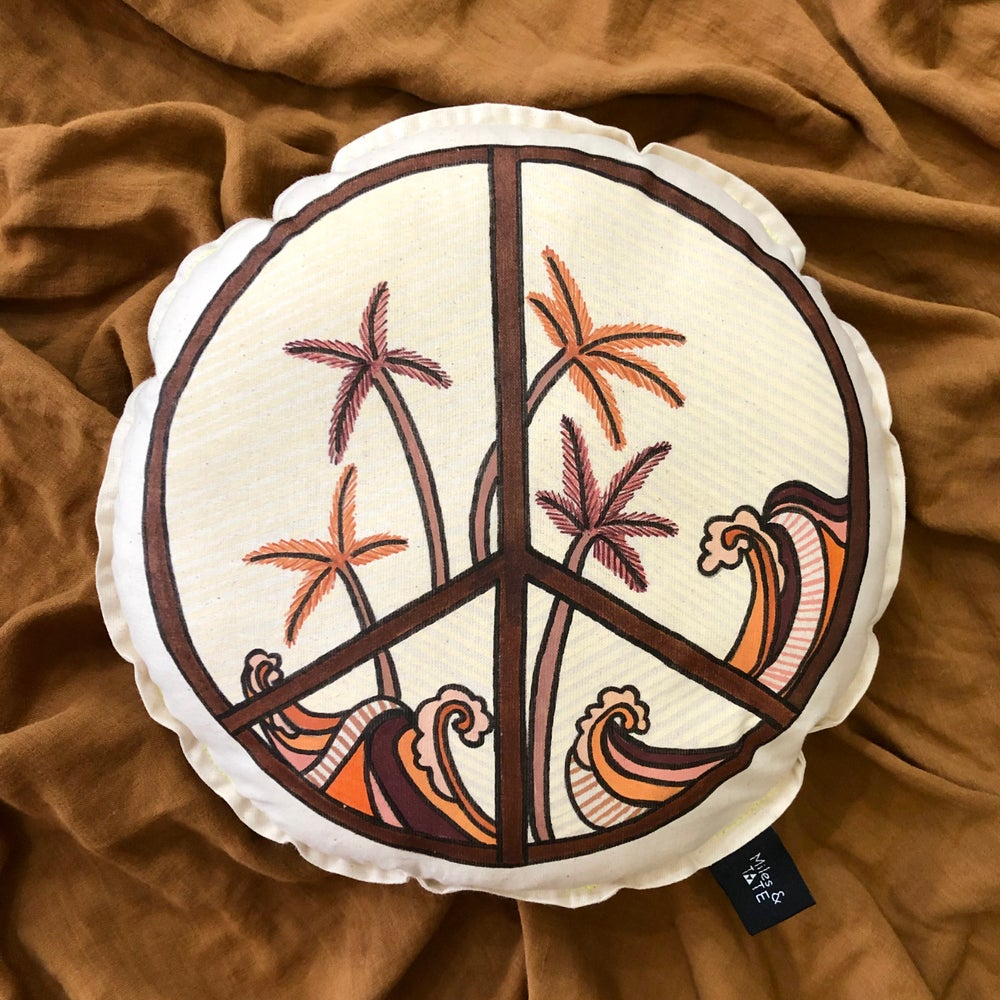 Image of Vintage coastal peace sign cushion