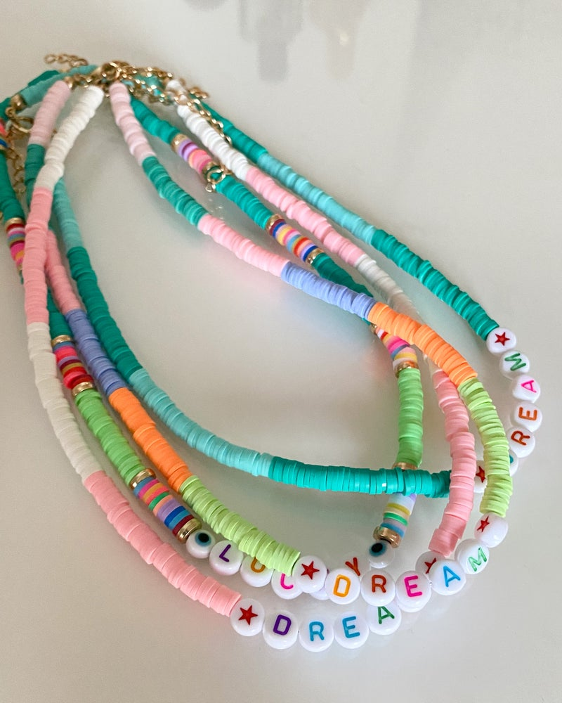 Image of COLLANA CANDY SCRITTE