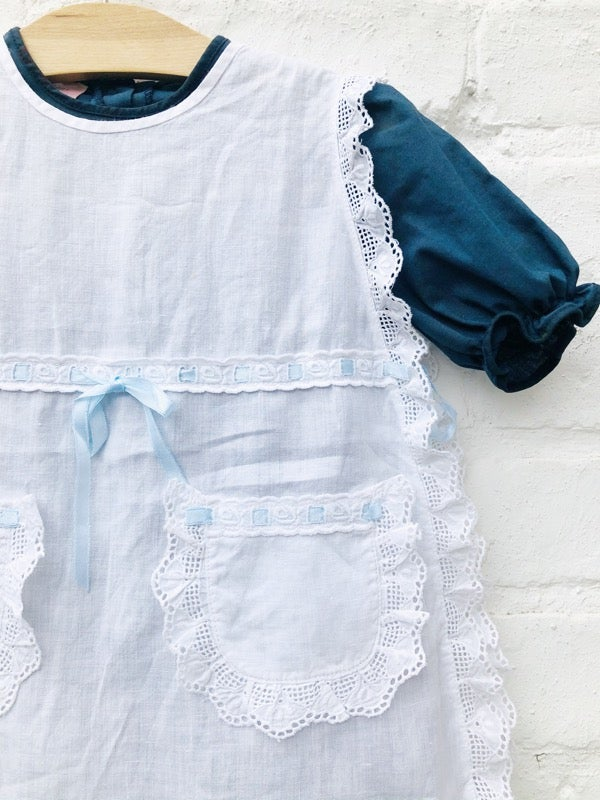 Image of Indigo overdyed underdress with white cotton tunic with Broderie Anglais and ribbon. Age 2-3yrs.