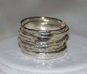 Image of Set of 9 handmade hammered sterling silver stackable rings, sizes 5, 6, 7, 8, 9, 10, 11