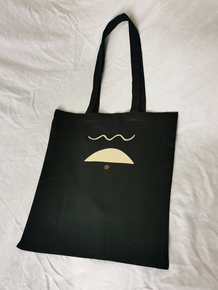 Image of black eye-d tote