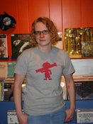 Image of The Official Kid with a Rocket Launcher logo T-Shirt (Heather Grey with cranberry logo)