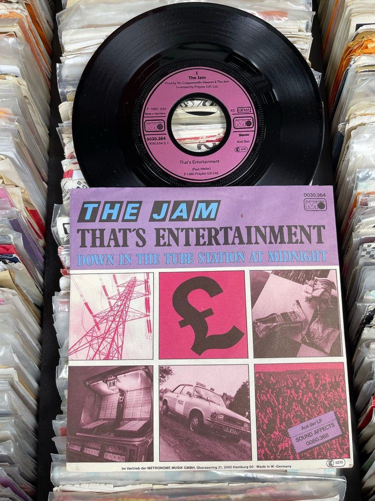 Image of The Jam-That's Entertainment b/w  Down In The Tube Station At Midnight deadstock German 7""