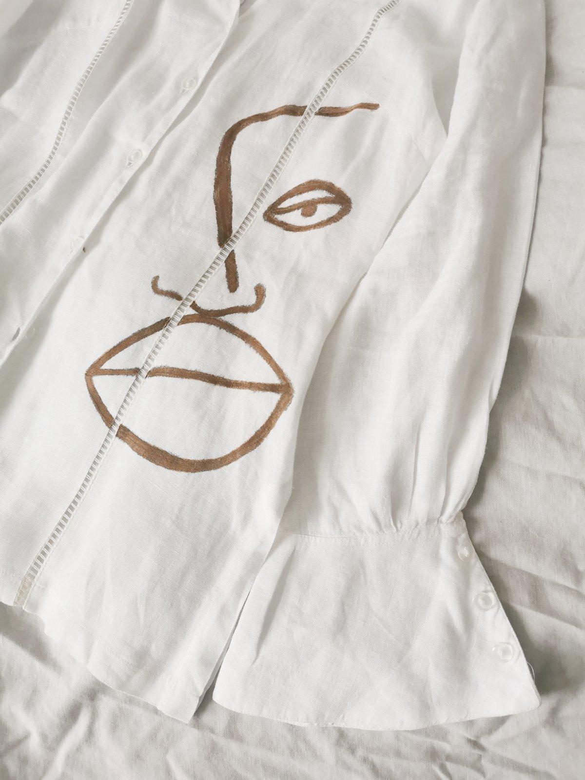 Image of stiritup blouse
