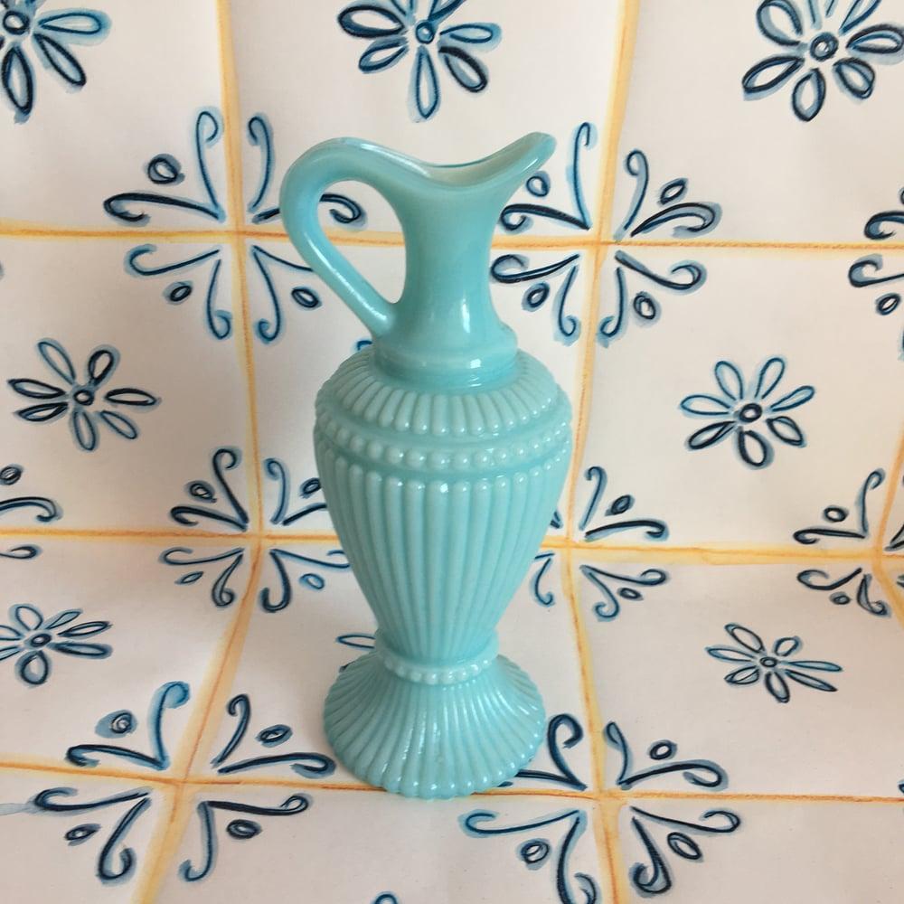 Image of Blue milk glass bottle.