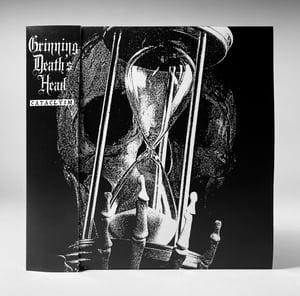 "Image of GRINNING DEATH'S HEAD ""CATACLYSM: GRIM RESOLVE"" 7"" TEST PRESS"