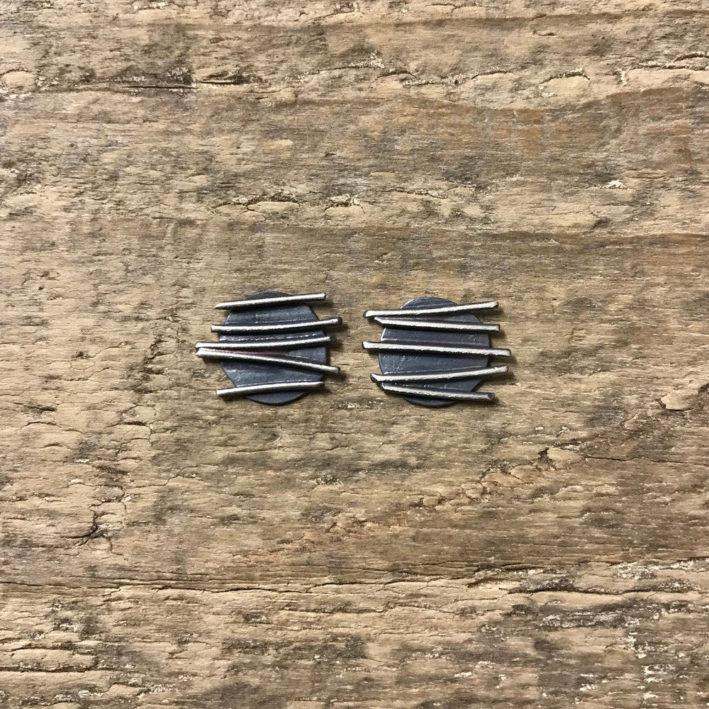 Image of small round blackened studs - textured organic earrings - brutalist circle studs