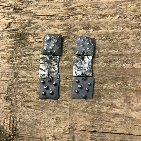 Image of blackened textured dangle earrings - brutalist statement studs - modernist stacked square earrings