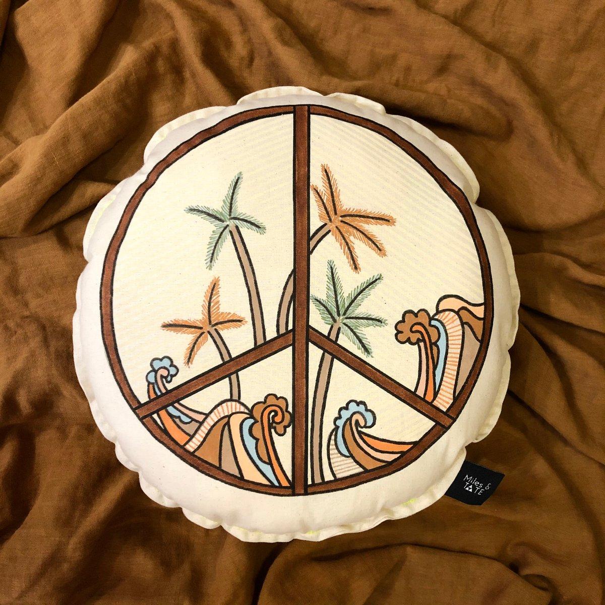 Image of Vintage coastal peace sign cushion