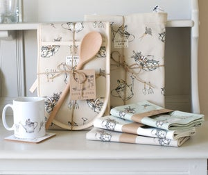 Image of Allotment print apron in beige