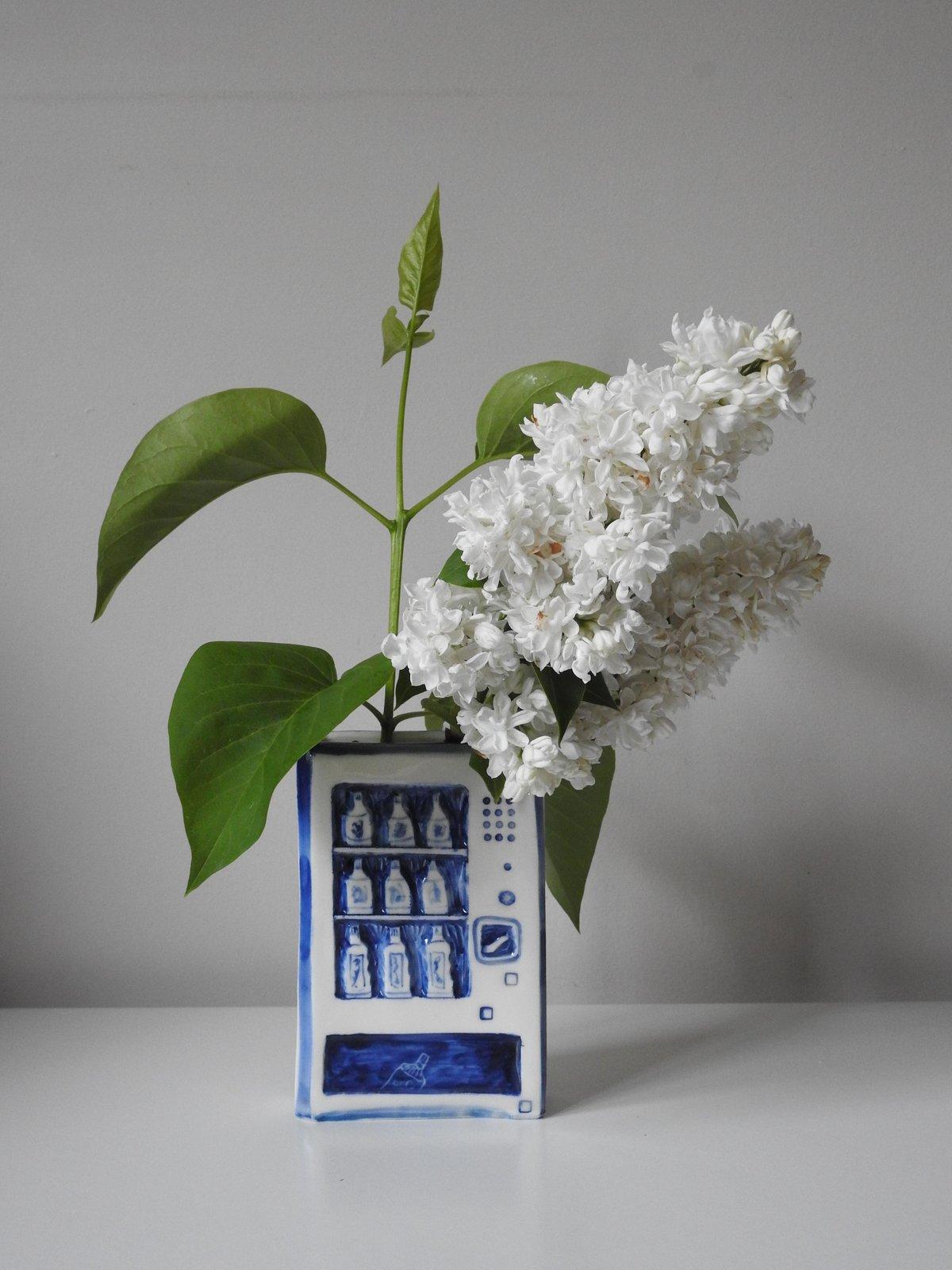 Image of blue and white vending machine - bud vase