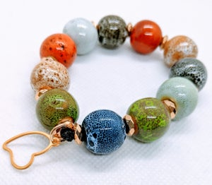 "Original ""Multiple Colorful Ceramic Balls Bracelet""  Enter DISCOUNT CODE: STONES29 at check out!"