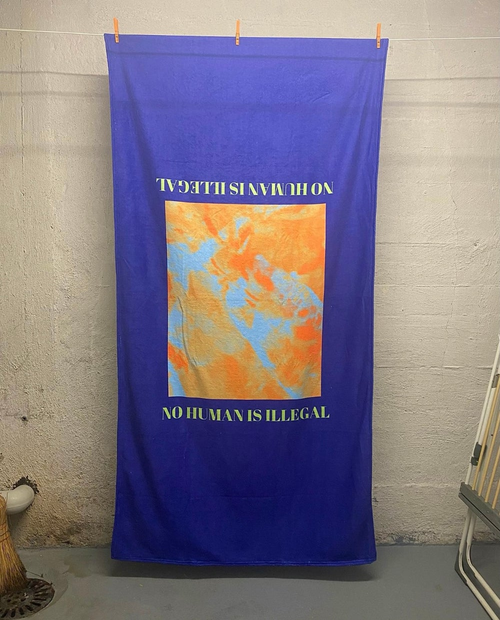 Image of BATH TOWEL - NO HUMAN IS ILLEGAL