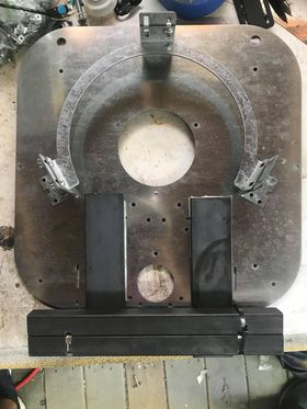Image of laser cut base plate and 9 lbs of steel weights