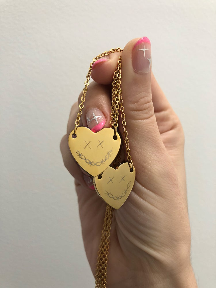 Image of BARBED WIRE SMILEY ENGRAVED HEART NECKLACE