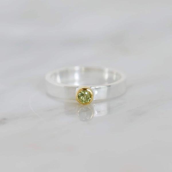 Image of Natural Peridot round cut 18k gold plated x silver band ring