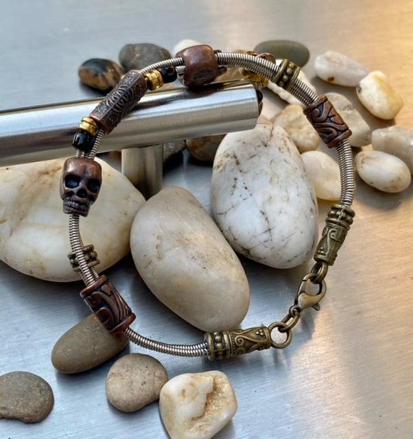 Image of Alaskan Played Bass String Skull Bracelet