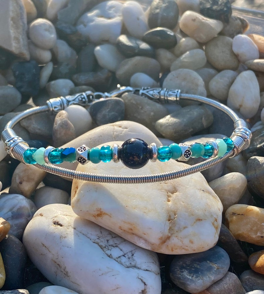Image of Alaskan Played Blue Gold Stone with Teal/ Blue mix Bass String Bracelet