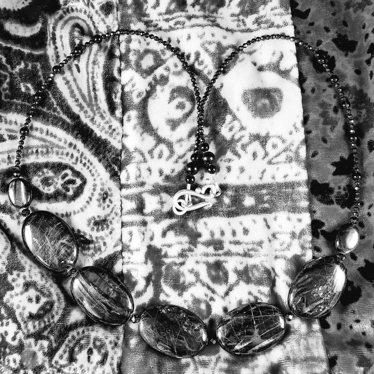 "Image of 24"" hypersthene, onyx, & black spinel statement strand"