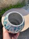 Organically shaped turquoise Raku vase