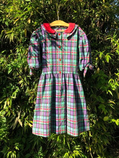 Image of Cotton shirtwaister in purple and green plaid. Age 7-9yrs.
