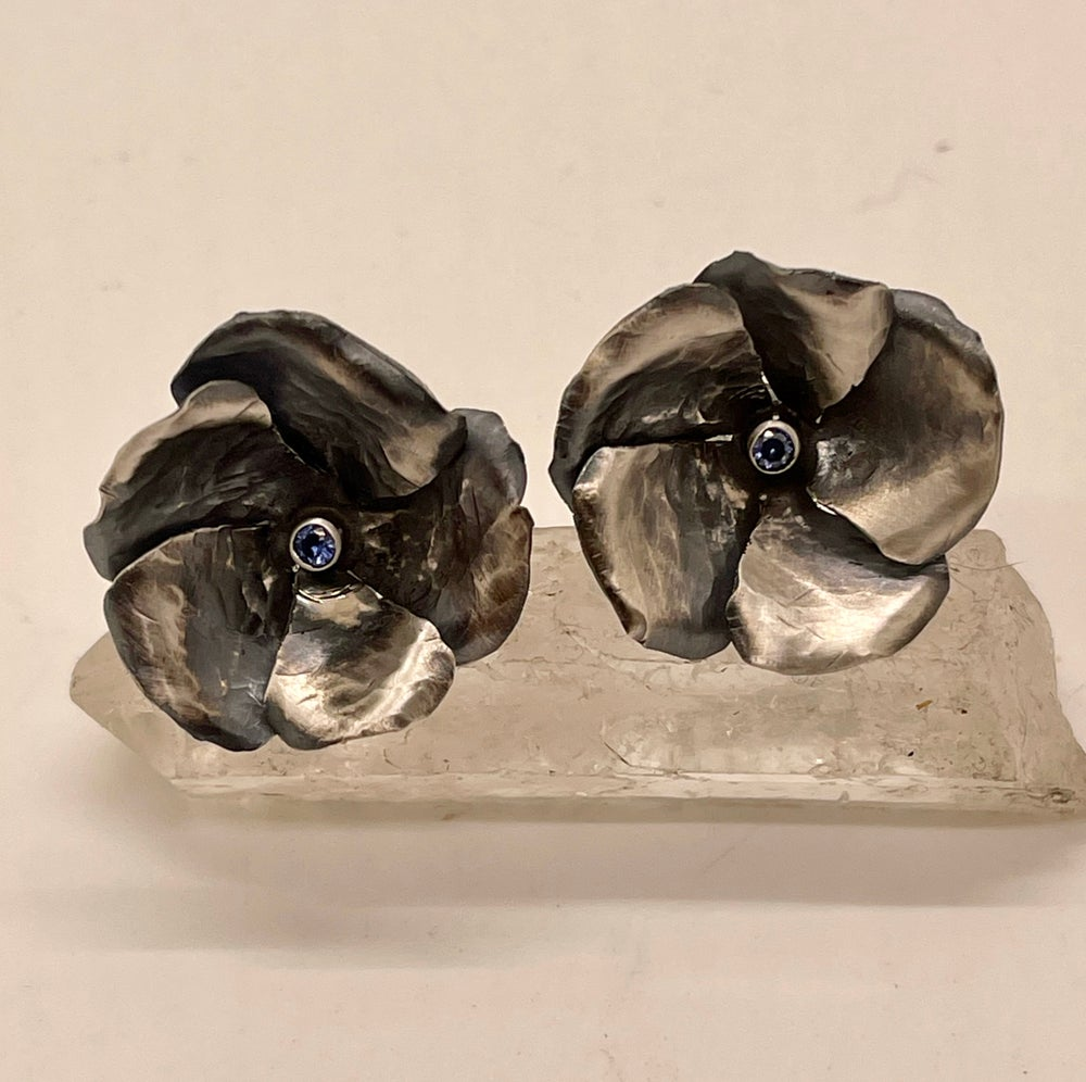 Image of Blossom Stud Earrings with blue Cubic Zirconium stones.