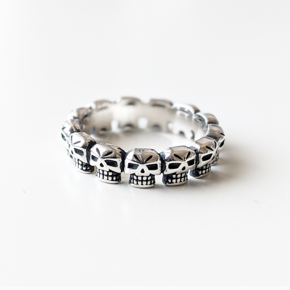 Image of Sterling Silver Band Of Skulls Ring