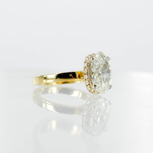 Image of 18ct yellow gold halo oval diamond engagement ring. Pj5685
