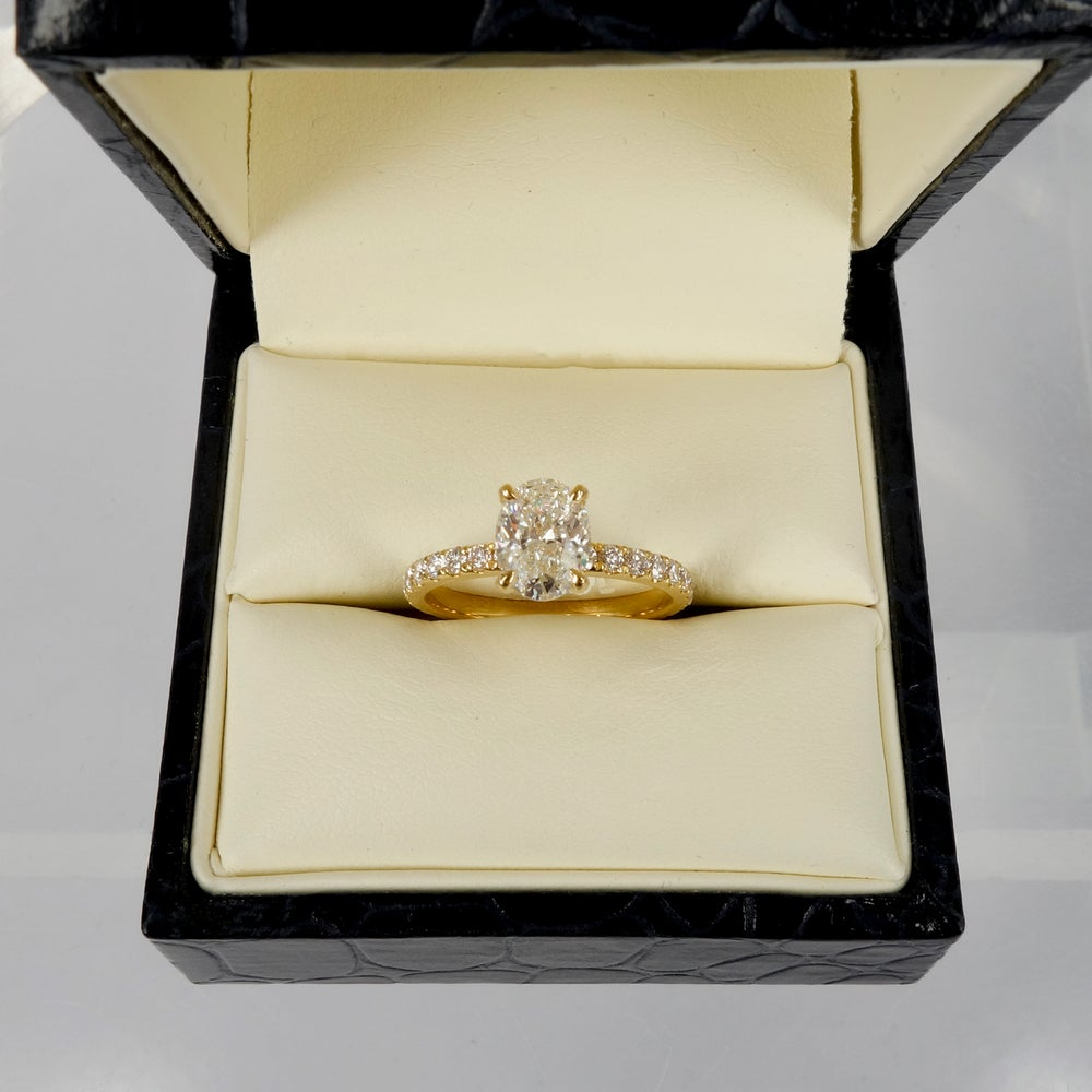 Image of 18ct yellow gold oval diamond solitaire engagement ring. pj5812