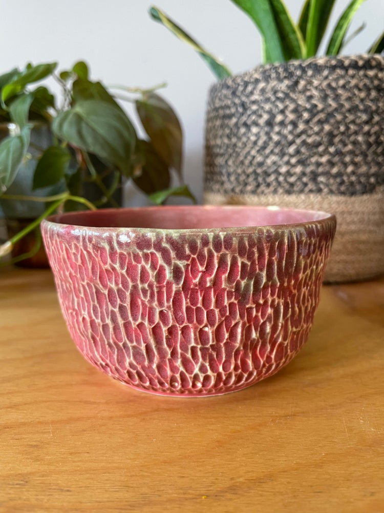 Image of Pink and teal carved bowl