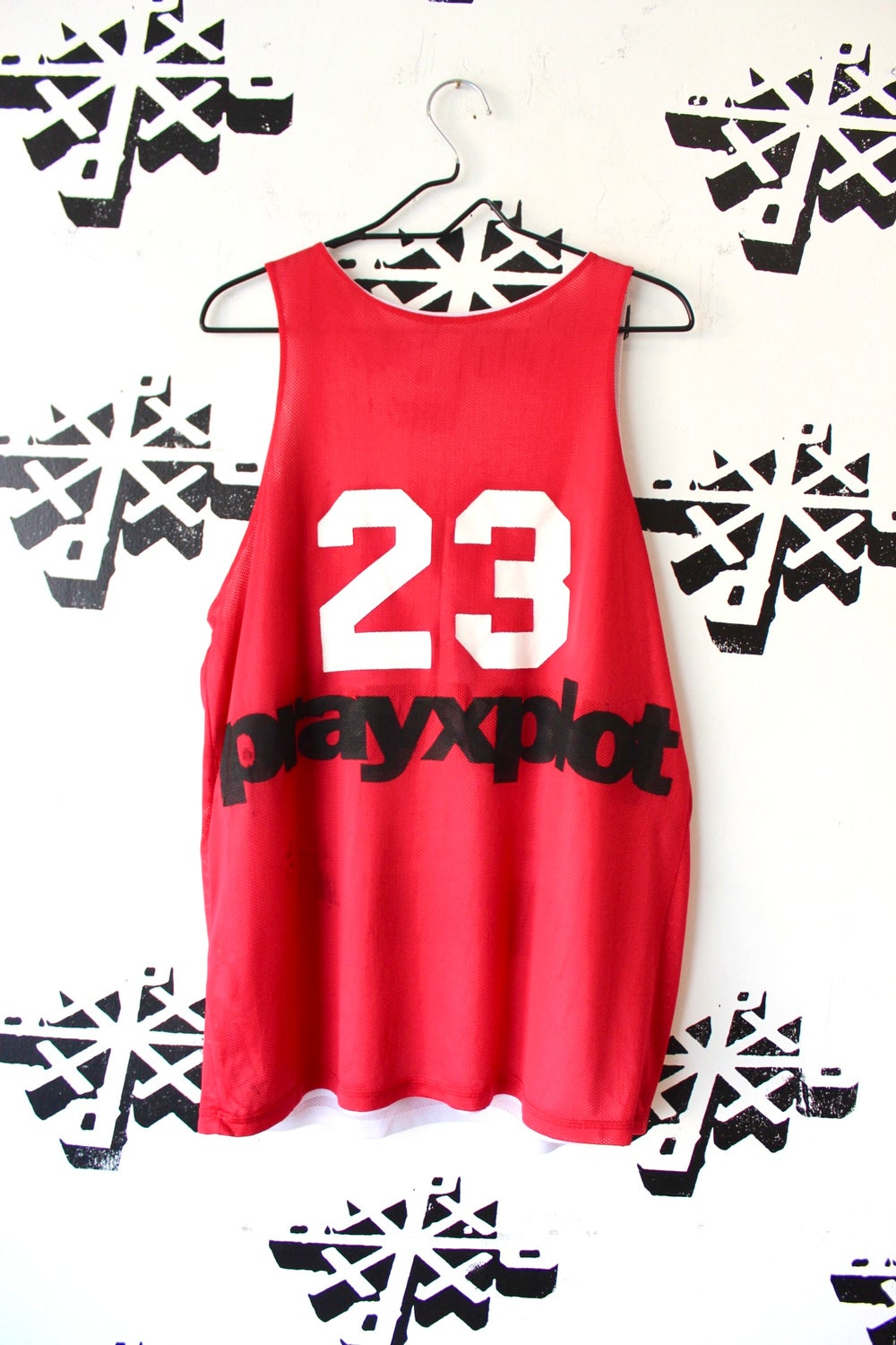 trained shooter jersey in red and white