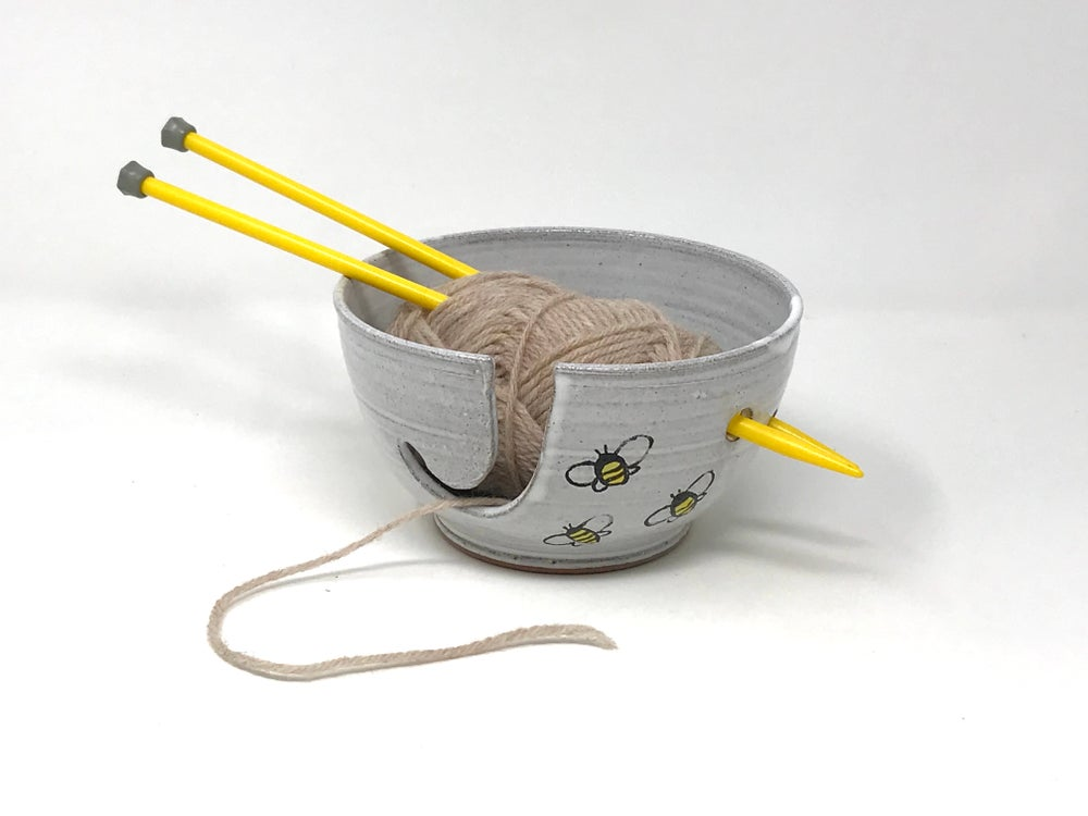 Image of White glazed Bee decorated String Bowl