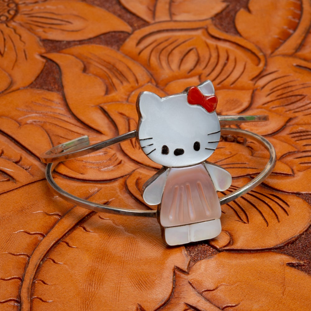 Image of Zuni Mother Of Pearl Chanel Inlay Sterling Silver Hello Kitty Bracelet size small