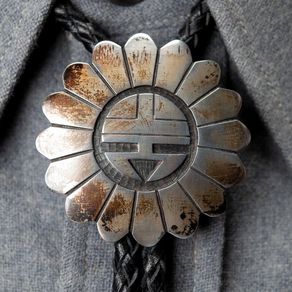 Image of Hopi Silversmith Michael Sockyma Native American Zia Sunface Sterling Silver Overlay Bolo Tie
