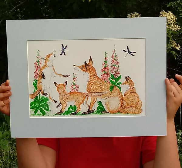 Image of Fox and cubs in the foxgloves