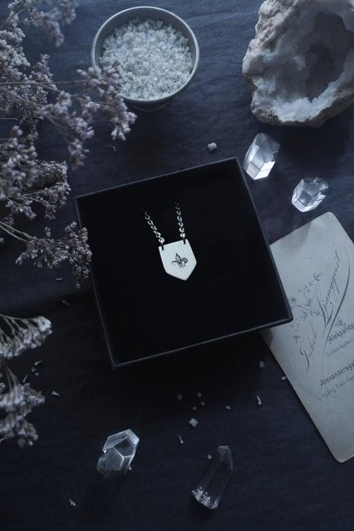 Image of FLEUR DE LYS EMBLEM. METAL NOIR QUEBECOIS, SHIELD AMULET ↟ sustainable sterling silver