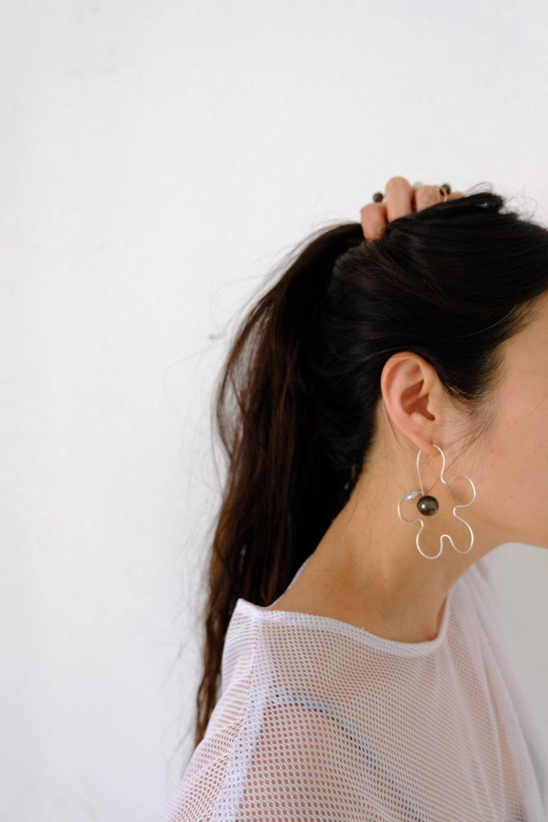Image of daisy silhouette earring