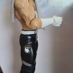 Image of Logan Easton Laroux Action Figure