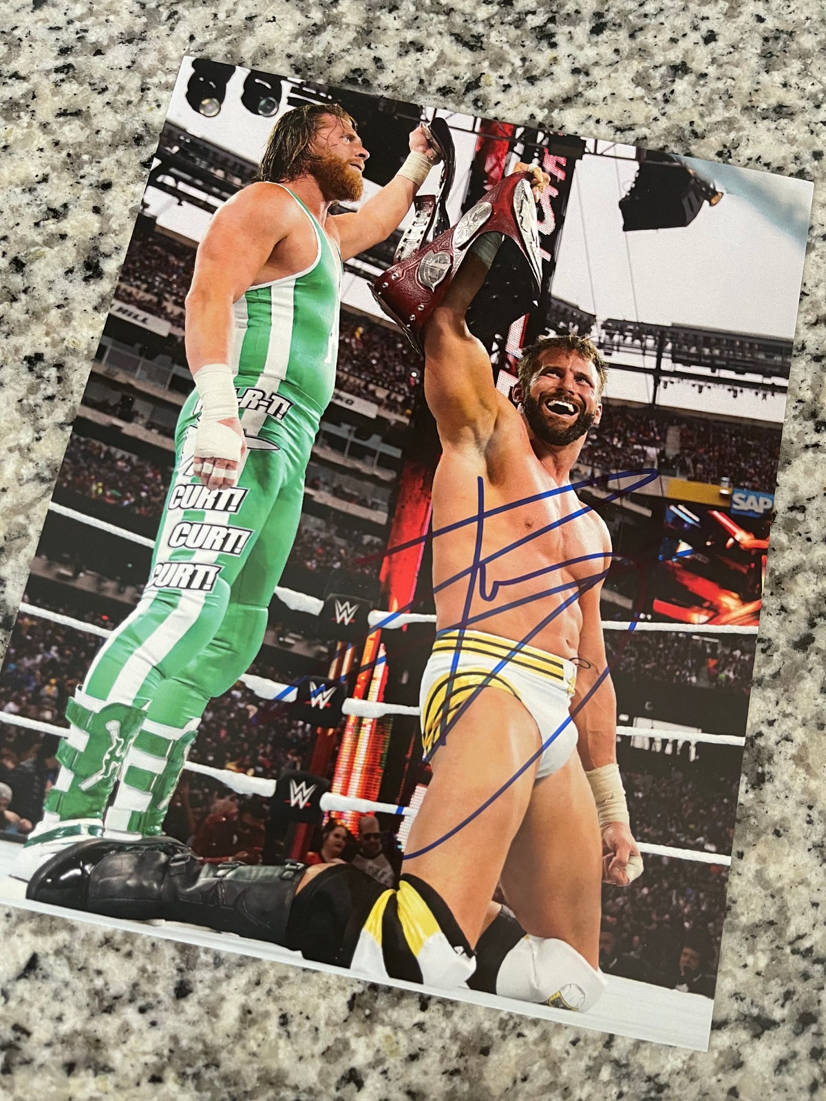 TAG TITLES AUTOGRAPHED 8x10