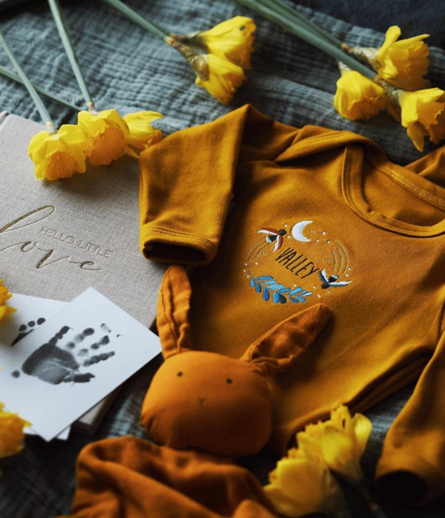 Image of Fireflies - mustard baby grow