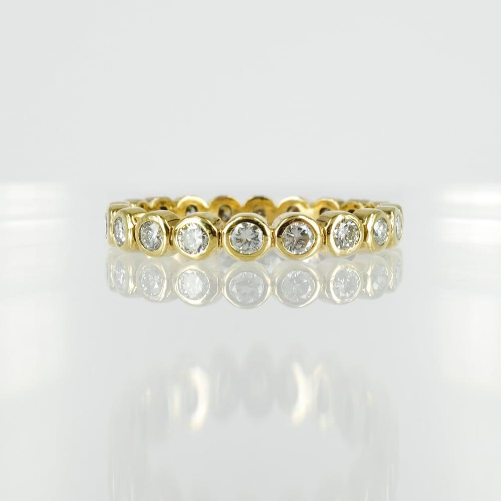 Image of 9ct yellow gold full circle diamond set eternity ring.  Pj0670