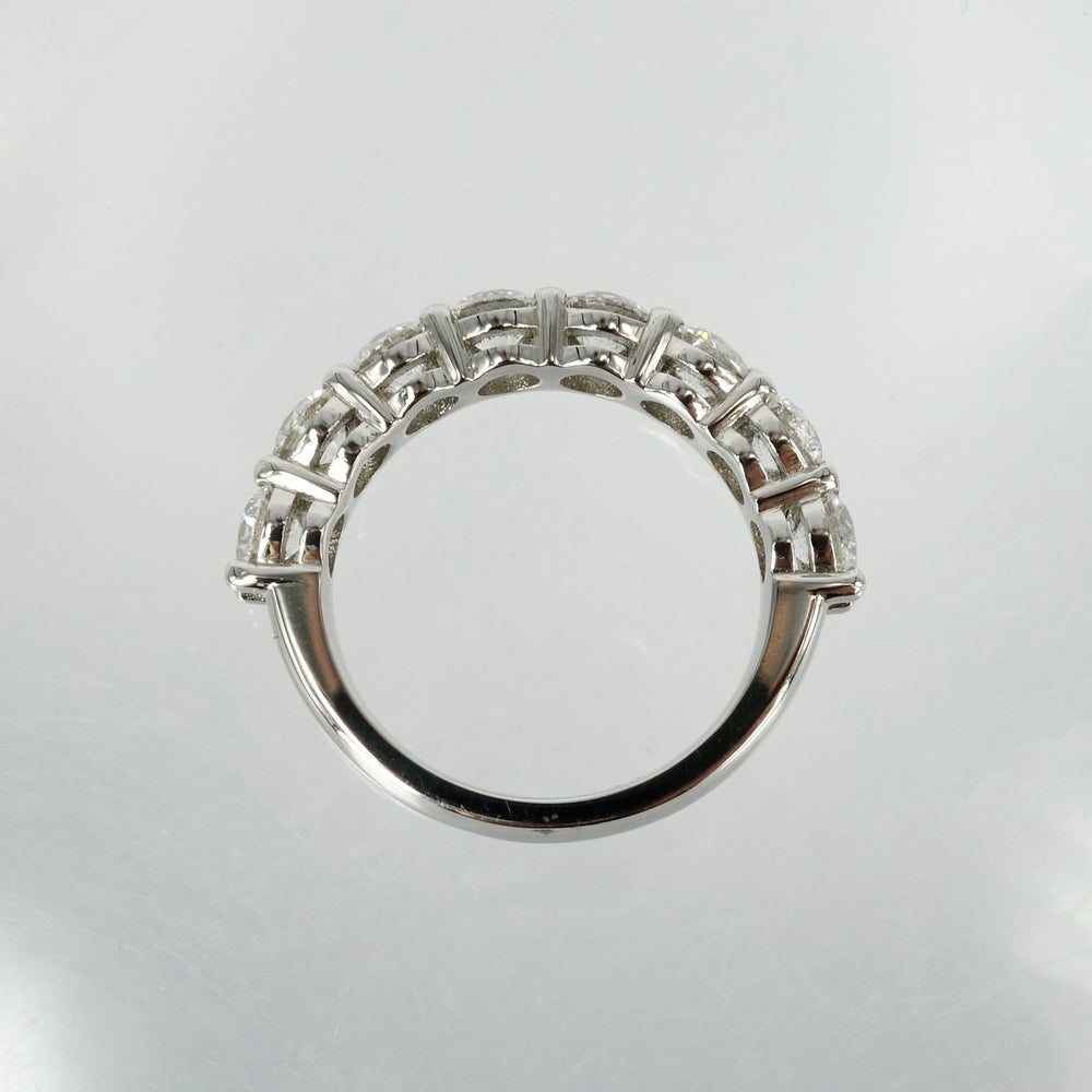 Image of 18ct white gold shared claw diamond set eternity ring.Pj5738