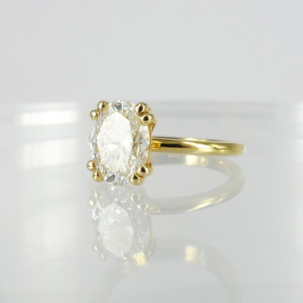 Image of 18ct yellow  gold 1.80ct oval diamond solitaire engagement ring. PJ5785