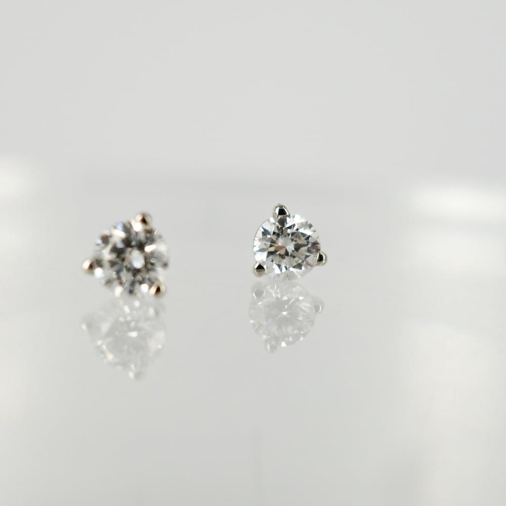 Image of 14ct white gold diamond studs. 2 = .55ct FSI1. Pj5804