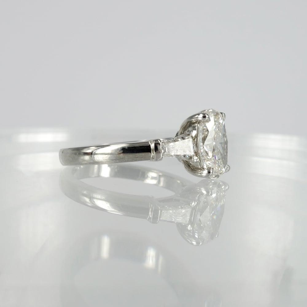 Image of Stunning 18ct white gold oval + baguette diamond ring. PJ5811