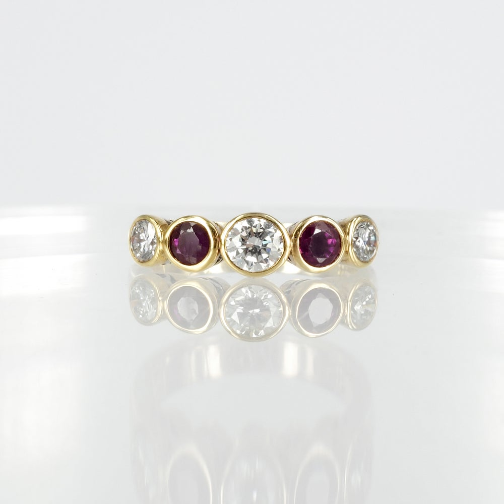Image of 18ct yellow gold bezel set diamond and garnet dress ring.